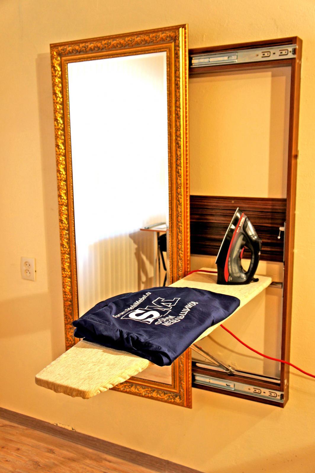 Фото: гладильная доска за зеркалом. Інші товари для дому, ук.